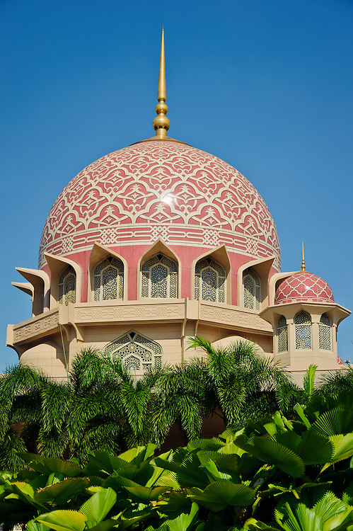 Stock photograph of the Putra Mosque in Putrajaya, Malaysia showing the warm pink tiles on te cupola.