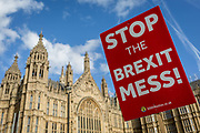 A pro-EU Stop This Brexit Mess placard and the UK Houses of Parliament during the continuing protest against Brexit, on 19th February 2019, in London, England.