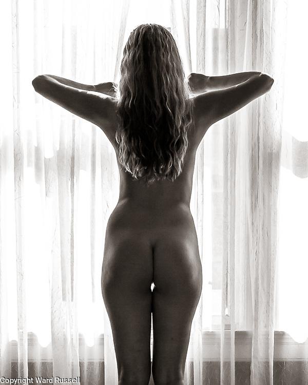Nude posing.