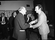 People Of The Year Awards.    (N74).1981..05.05.1981..5th May 1981..Dr Michael Woods TD,Minister for Health & Social Welfare, today presented 73 People of The Year Lapel Emblems at an official ceremony in the New Ireland Assurance Co., Ltd, Dawson Street, Dublin. The lapel emblems were created as a result of recipients of the awards seeking to promote their work by identifying with the awards. It is intended that future recipients of The People Of The Year Awards silver medallions would also receive a lapel emblem...Image shows the Minister,Michael Woods,presenting an award at the ceremony.