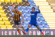 AFC Wimbledon defender Cheye Alexander (7) battles with Hull City midfielder Greg Docherty (33) during the EFL Sky Bet League 1 match between AFC Wimbledon and Hull City at Plough Lane, London, United Kingdom on 27 February 2021.