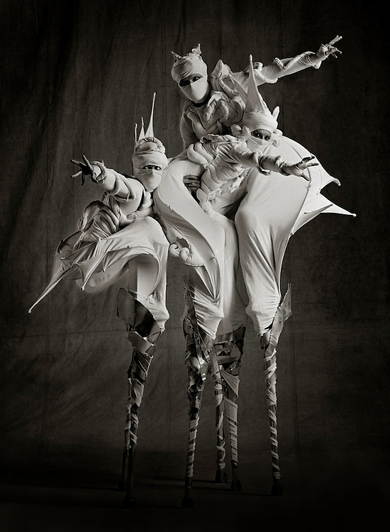 Three guys on stilts Ray Massey is an established, award winning, UK professional  photographer, shooting creative advertising and editorial images from his stunning studio in a converted church in Camden Town, London NW1. Ray Massey specialises in drinks and liquids, still life and hands, product, gymnastics, special effects (sfx) and location photography. He is particularly known for dynamic high speed action shots of pours, bubbles, splashes and explosions in beers, champagnes, sodas, cocktails and beverages of all descriptions, as well as perfumes, paint, ink, water – even ice! Ray Massey works throughout the world with advertising agencies, designers, design groups, PR companies and directly with clients. He regularly manages the entire creative process, including post-production composition, manipulation and retouching, working with his team of retouchers to produce final images ready for publication.