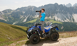 Photographer in mountain landscape Quad bike