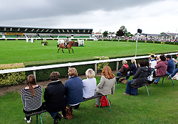 © Licensed to London News Pictures.14/07/15<br /> Harrogate, UK. <br /> <br /> Spectators sit and watch the show jumping on the opening day of the Great Yorkshire Show.  <br /> <br /> England's premier agricultural show opened it's gates today for the start of three days of showcasing the best in British farming and the countryside.<br /> <br /> The event, which attracts over 130,000 visitors each year displays the cream of the country's livestock and offers numerous displays and events giving the chance for visitors to see many different countryside activities.<br /> <br /> Photo credit : Ian Forsyth/LNP