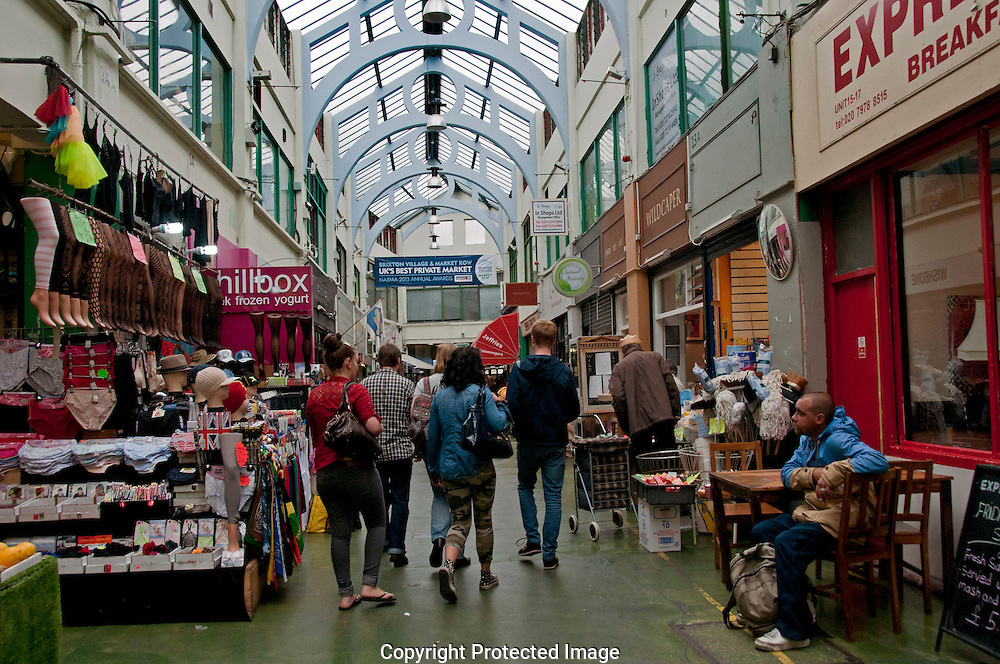 Market Row in The village in Brixton with stalls and food