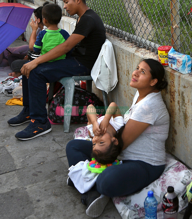 July 4, 2018 - Matamoros, Mexico - July 4, 2018 Ð Matamoros, Mexico - Diana Zumiga, 31 and 8-months pregnant sleeps on bridge with her daughter Daylin Zuniga, 3 years old. They are from Guatemala.  Her father Hentry Zuniga brought them here as he said it was unsafe in their homeland, but does not plan to cross. Others on bridge requested not to be identified. Asylum seekers sleep on B/M International Bridge, Matamoros-Brownsville, waiting to cross into U.S. from Mexico side. If not for a small humanitarian group Asociacion Civil Ayudandoles a Triunfar a.c. run by Glady Canas from Mexico they would have not had blankets to sleep on, food, water, etc.  It is unknown whether they have as yet been allowed in to be processed for credible fear. Later that night in the far distance, fireworks went off as America celebrated Independence Day. (Credit Image: © Carol Guzy via ZUMA Wire)