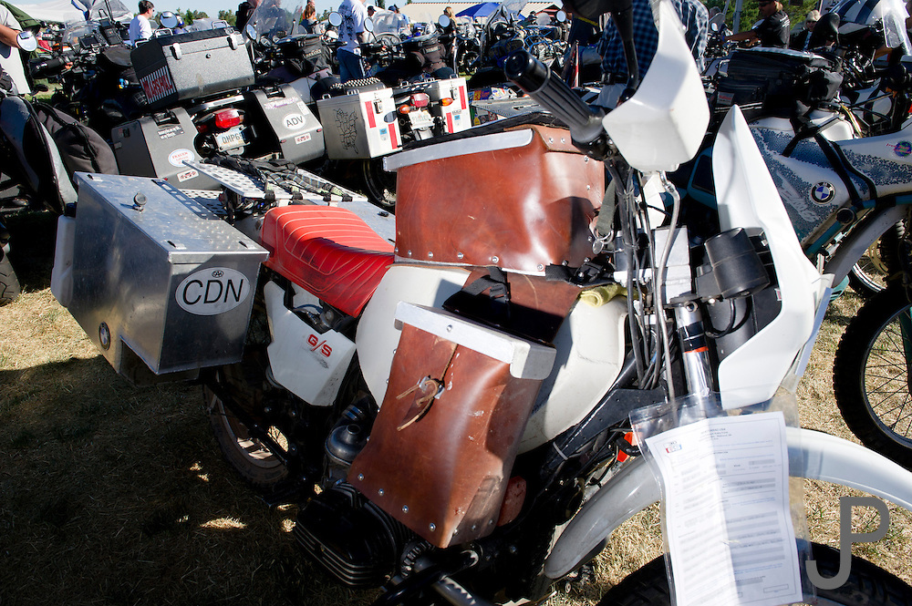 A GS adorned with hand-made leather side panniers and tank bag.  Chrome is not a common site at a BMW rally.