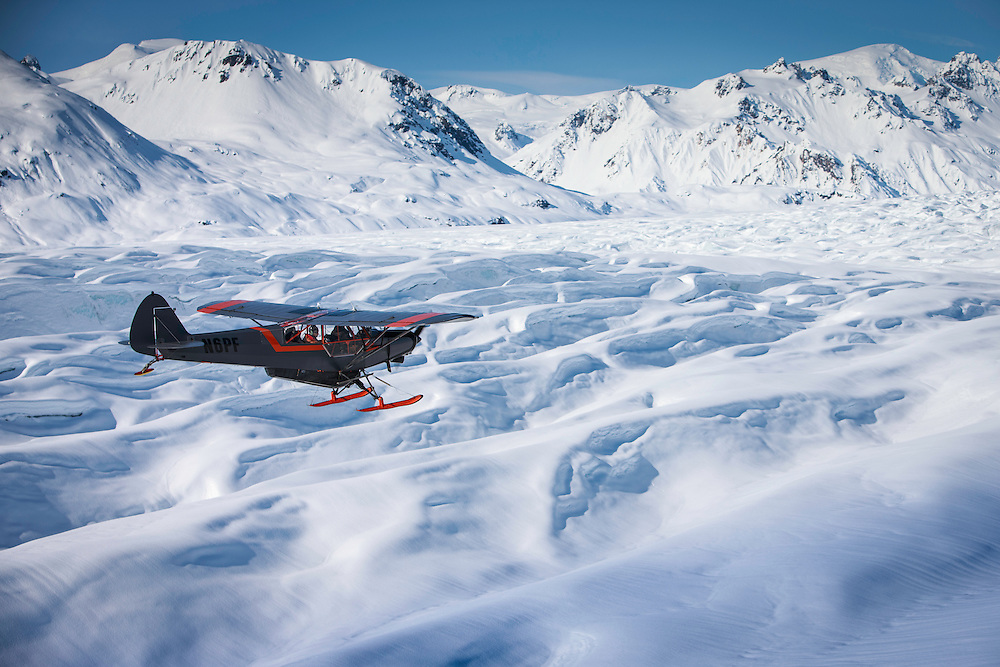 Jon Devore scouts the skiable terrain by plane before filming of the Unrideables in the Tordrillo Mountains near Anchorage, Alaska on April 20th, 2014.