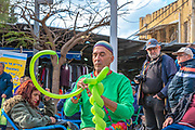 Balloon artist creating art from balloons Photographed at Nachlat Binyamin Pedestrian street, Tel Aviv, Israel