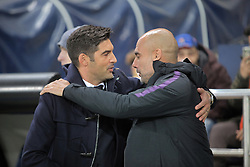 October 23, 2018 - Kharkiv, Ukraine - Head coach of FC Shakhtar Donetsk Paulo Fonseca (L) and head coach of Manchester City FC Josep Guardiola share an embrace before the UEFA Champions League Group F Matchday 3 game at the Metalist Stadium Regional Sports Complex, Kharkiv, northeastern Ukraine, October 23, 2018. Ukrinform. (Credit Image: © Vyacheslav Madiyevskyy/Ukrinform via ZUMA Wire)