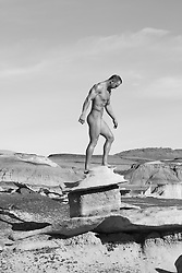 male nude and rock formation