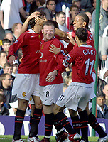 Fotball<br /> England<br /> Wayne Rooney<br /> Foto: Colorsport/Digitalsport<br /> NORWAY ONLY<br /> <br /> Ruud Van Nistelrooy (Utd) celebrates his 2nd goal with Wayne Rooney,Ryan Giggs and Rio Ferdinand. Fulham v Manchester United. 1/10/2005