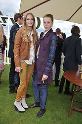 Left to right, sisters OLYMPIA CAMPBELL and EDIE CAMPBELL at the Cartier Queen's Cup Polo Final, Guards Polo Club, Windsor Great Park, Berkshire, on 17th June 2012.