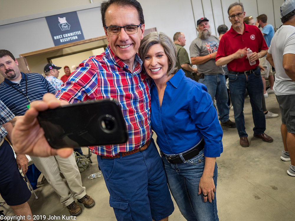 "15 JUNE 2019 - BOONE, IOWA: US Senator JONI ERNST (R-IA) poses for a selfie at ""Joni's Roast and Ride,"" a motorcycle ride / fund raiser hosted by Ernst. Ernst, Iowa's junior US Senator, kicked off her re-election campaign during the ""Roast and Ride"", an annual fund raiser and campaign event has she held since originally being elected to the US Senate in 2014.    PHOTO BY JACK KURTZ"