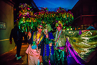 Fat Tuesday revelers at twilight, Mardi Gras, French Quarter, New Orleans, Louisiana USA