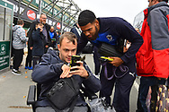 Jake Jervis (10) of AFC Wimbledon having a photo with a fan on arrival at Home Park stadium before the EFL Sky Bet League 1 match between Plymouth Argyle and AFC Wimbledon at Home Park, Plymouth, England on 6 October 2018.