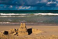 Sand Castle on Kailua Beach, with rainbow in the background, Oahu, Hawaii