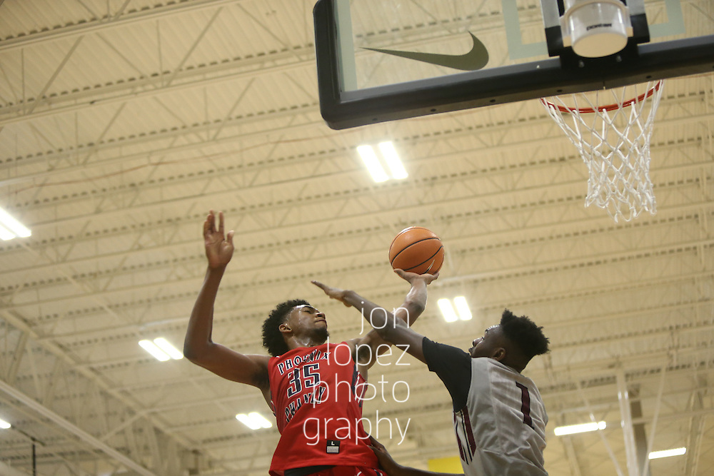 Westfield, IN - APRIL 23: Nike EYBL. Session 2. Marvin Bagley III #35 of Phoenix Family shoots over the defense of Lance Thomas #1 of Team United. (Photo by Jon Lopez)