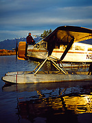 Rob Everts on nose of his 1929 metalized Travelaire, Lake Hood, Anchorage, Alaska.