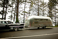 Vistors and sites at Devils Churn state park near Yachats, Oregon.  A classic car pulls an airstream trailer.