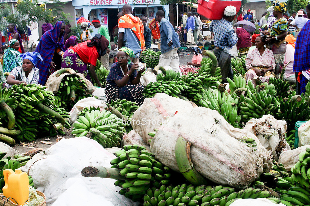 Africa, Tanzania, Frontier Market selling bananas The goods are placed on a blanket on the ground