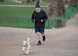© Licensed to London News Pictures. 15/03/2021. London, UK. British Prime Minster BORIS JOHSON jogging in Westminster, London. There have been calls for Met Chief Cressida Dick to resign following after police dragged women away from a bandstand at a vigil for murdered Sarah Everard in Clapham, South London. Photo credit: Ben Cawthra/LNP