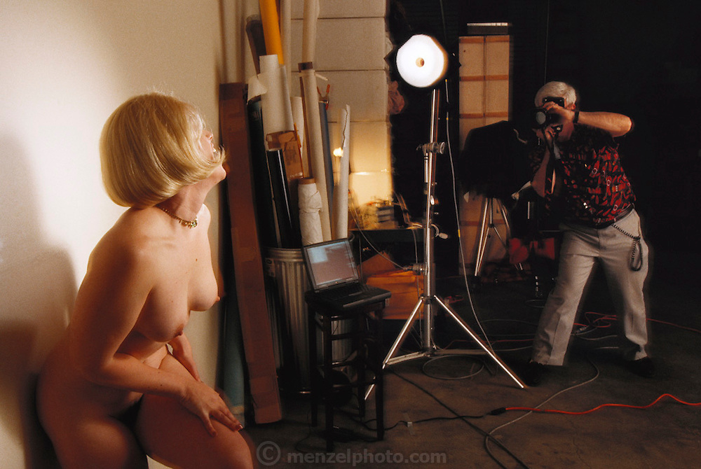 """Silicon Valley, California; Romana Machado being photographed for her """"Peek of the week"""" web site where she sells nude pictures of herself. Model released. (1999)."""