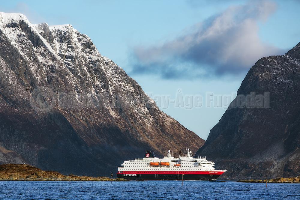 MS Richard With sailing into Herøyfjord, Norway   Hurtigruteskipet MS Richard With seiler inn i Herøyfjord, Norge. Skorpesundet i bakgrunnen og Flåvær i forgrunn.