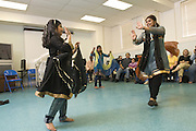 Student Preeti Tanwani, 8, left, and dancer Vindhya Katta, right, demonstrate Nachale: The Bollywood Dance Workout with Kavya Nair, 10, center, and Arika Diwedi, 10, and Shloka Nair, 9, during the English Conversation Club: Dance and Dialogue event Saturday April 9, 2011 at the Iroquois Branch of the Louisville Free Public Library in Louisville, Ky. Henna and Bindi followed the Bollywood dance lesson, and then volunteers were paired with English language learners to work on conversation skills. (Photo by Brian Bohannon)