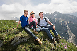 Father and kids enjoying mountains view