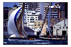 The waterfront of downtown Auckland is always close to the action with former cup entries like KZ 7 racing as part of the series of regattas alongside the main event...New Zealand, a country that absorbs their sportng achievements into legend. The America's Cup, the oldest sporting trophy,  won and retained by an NZ based syndicate, with considerable state aid and of course the support of the people, in their droves...Marc Turner / PFM