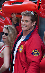 "© Licensed to London News Pictures. 18/05/2012. London, England. Photocall with U.S. American actor David Hasselhoff. Hasselhoff poses in Baywatch gear alongside KITT, the talking car from the series ""Knight Rider"" which made him famous before performing a one-man show ""An Evening with David Hasselhoff Live"" at the Leicester Square Theatre. Two performances in London (17/18th August) and from 21-27 August in Edinburgh. Photo credit: Bettina Strenske/LNP"
