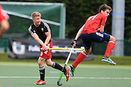Rhodri Furlong of Wales (l) has a shot blocked by Edouard Delobelle of France.  Mens international hockey, Wales v France at the National Hockey Centre, Sophia Gardens in Cardiff, South Wales on Thursday 21st April 2016.<br /> pic by Andrew Orchard, Andrew Orchard sports photography.