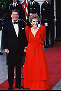 President Ronald Reagan and First Lady Nancy Reagan waiting for the arrival of De La Madrid,, President of Mexico  at the White House for a state dinner on May 15, 1984.<br /> <br /> by Dennis Brack