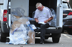 © Licensed to London News Pictures. 08/08/2018<br /> Deptford, UK. Police evidence bags being gathered outside a property where 7 year Joel Urhie was killed in a suspicious house fire at Adolphus Street, Deptford.  <br /> Photo credit: Grant Falvey/LNP