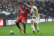 Grimsby Town striker Wes Thomas (39) battles for possession  with Milton Keynes Dons defender Baily Cargill (26) during the EFL Sky Bet League 2 match between Milton Keynes Dons and Grimsby Town FC at stadium:mk, Milton Keynes, England on 21 August 2018.