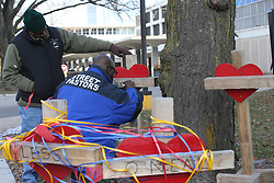 November 20, 2018 - Chicago, IL, USA - Ziff Sistrunk, left, and Donovan Price, place crosses at Chicago Mercy Hospital to remember the shooting victims on November 20, 2018. (Credit Image: © Antonio Perez/Chicago Tribune/TNS via ZUMA Wire)