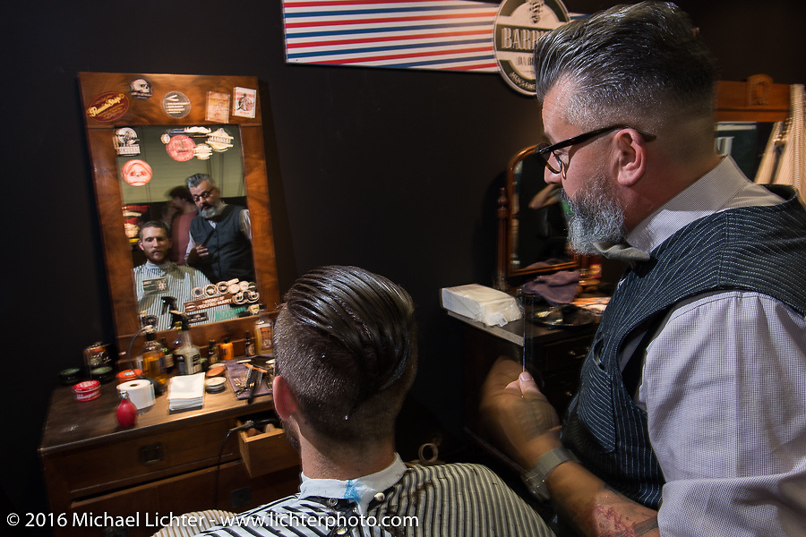 Several barbers worked Hall 10 with its all-custom focus at the Intermot Motorcycle Trade Fair. Cologne, Germany. Thursday October 6, 2016. Photography ©2016 Michael Lichter.