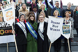 "© Licensed to London News Pictures. 08/03/2015. London, UK.Helen Pankhurst, Gemma Arterton and Laura Pankhurst at the ""Walk In Her Shoes"" event to mark International Women's Day at The Scoop amphitheatre on the south bank in London. Photo credit : Vickie Flores/LNP"
