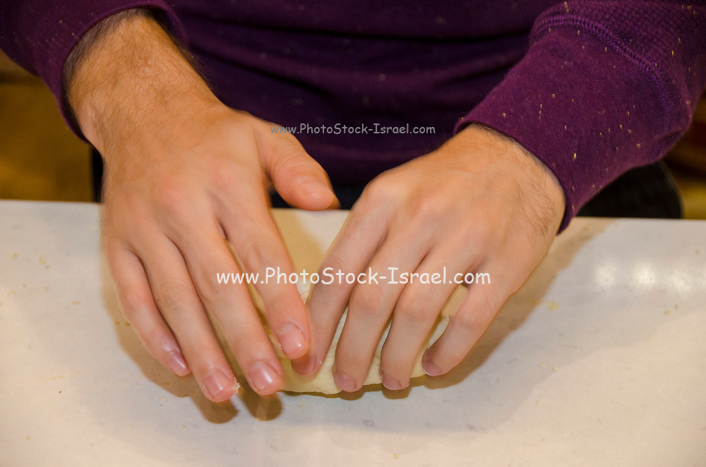 close up of the Hands of a female pastry chef as she demonstrates how to  knead dough at a baking workshop