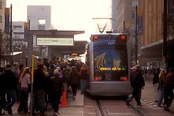 Metro light rail train running down Main Street in downtown Houston