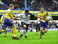 Photo. Glyn Thomas.<br /> Fulham v Southampton. FA Barclaycard Premiership. <br /> Loftus Road, London. 26/12/2003.<br /> Fulham's Steed Malbranque (C) forces his way past Jason Dodd (R) and Michael Svensson.