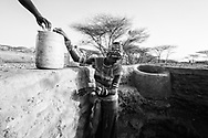 Nkideson Sahado, draws water from a well in Korr. Not a BOMA Project participant.