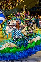Flag bearer (porta bandeira) in the Carnaval parade of Academicos do Sossego samba school in the Sambadrome, Rio de Janeiro, Brazil.