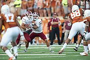 AUSTIN, TX - AUGUST 31: Andrew McDonald #12 of the New Mexico State Aggies hands the ball off to Brandon Betancourt #21 against the Texas Longhorns on August 31, 2013 at Darrell K Royal-Texas Memorial Stadium in Austin, Texas.  (Photo by Cooper Neill/Getty Images) *** Local Caption *** Andrew McDonald; Brandon Betancourt