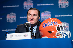 Florida Gators head coach Dan Mullen and Michigan Wolverines head coach Jim Harbaugh speak with the media at the coaches news conference on Friday, December 28, 2018 in Atlanta. Florida and Michigan face off in the Peach Bowl NCAA football game on December 29, 2018. (Paul Abell via Abell Images for the Chick-fil-A Peach Bowl)