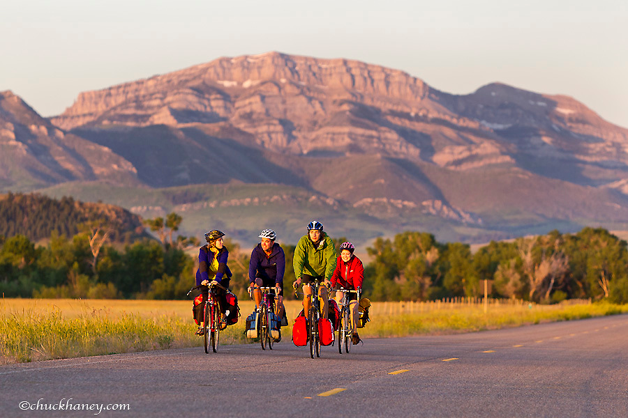 Bicycle touring with Steamboat Mountain in background on Highway 435 near Augusta, Montana, USA model released
