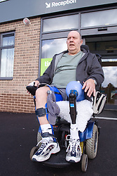 Male wheelchair leaving his local sports leisure centre,