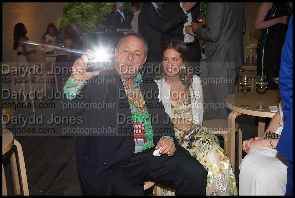 JOHNNY PIGOZZI; DASHA ZHUKOVA, 2014 Serpentine's summer party sponsored by Brioni.with a pavilion designed this year by Chilean architect Smiljan Radic  Kensington Gdns. London. 1July 2014
