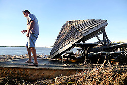 October 9, 2016 - Crescent Beach, Florida, U.S. - DOUGLAS R. CLIFFORD   |   Times.George Thornton, left, inspects damage to the Mantanzas Innlet Restaurant, 8805 A1A S, in St. Augustine, FL, which sat in ruins on Saturday (108/16) after being gutted and destroyed by Hurricane Matthew as it passed off Florida's east coast. Thronton is a neighbor of the restaurant's owners. (Credit Image: © Douglas R. Clifford/Tampa Bay Times via ZUMA Wire)